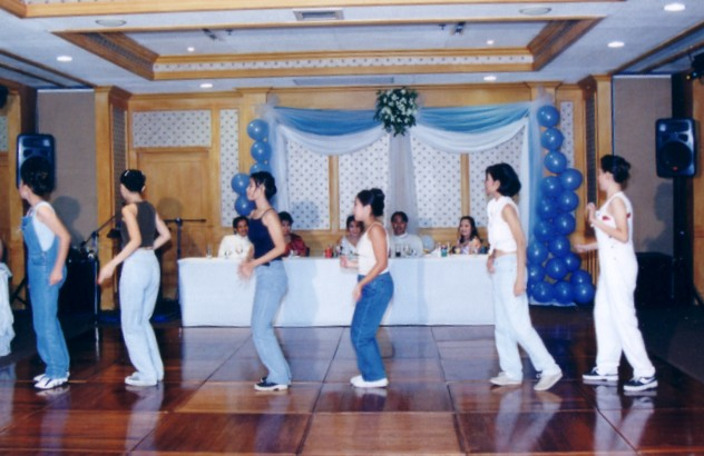"Cotillion girls dancing to All Saints' ""Lady Marmalade"""